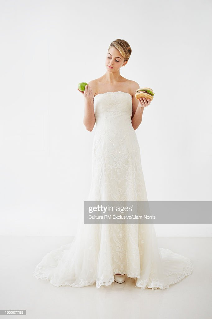Bride choosing burger or fruit