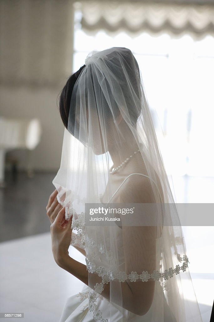 Bride covered in veil : Stock Photo