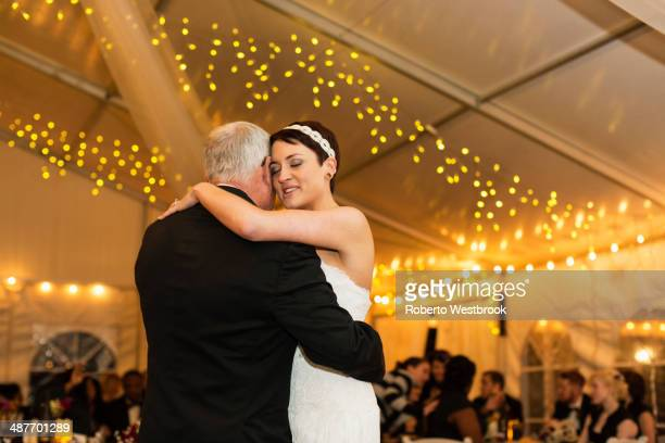 Bride dancing with father at reception