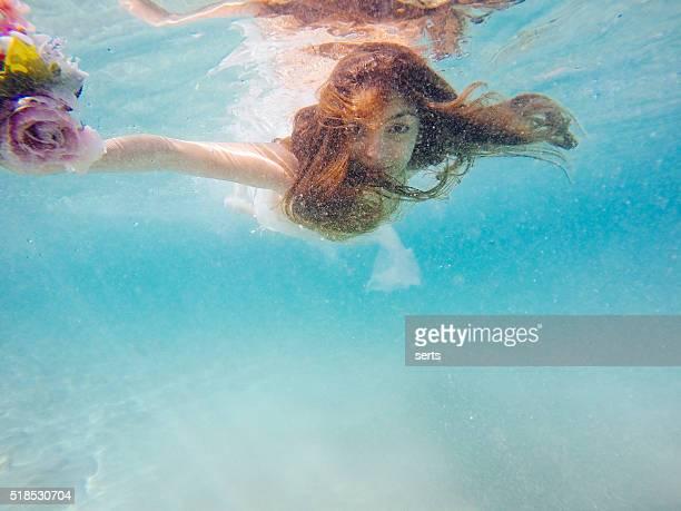 Bride enjoying underwater
