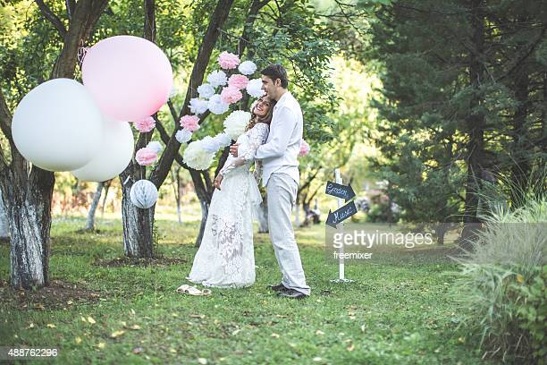 Bride, groom and balloons