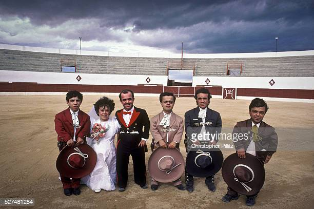 Bride groom Guillermo Gomez and his just married wife Joaquina together with their troupe of fellow dwarfs inside Cienpozuelo's bull ring after their...