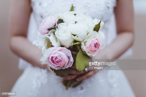 Bride hands holding bouquet