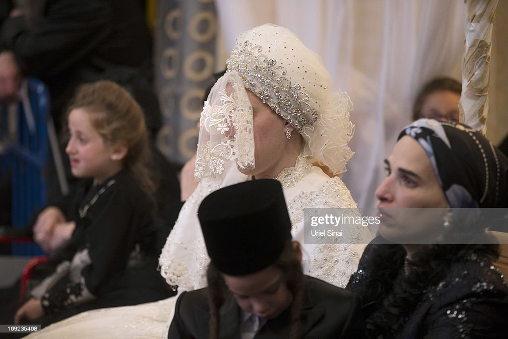 Bride Hannah Batya Penet, during her wedding ceremony to Rabbi Shalom Rokach, the Grandson of the Belz Rabbi, early morrning of May 22, 2013. in Jerusalem, Israel. Some 25,000 Ultra-Orthodox Jews participated in one of the biggest weddings of the of Ultra-Orthodox Jewish community in the past few years.