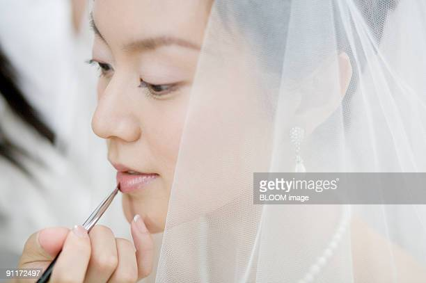 Bride having makeup put on her