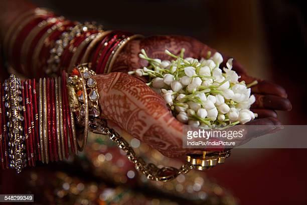 Bride holding jasmine flower