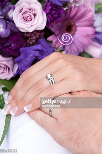 Bride Holding Purple Blue and Pink Flower Bouquet