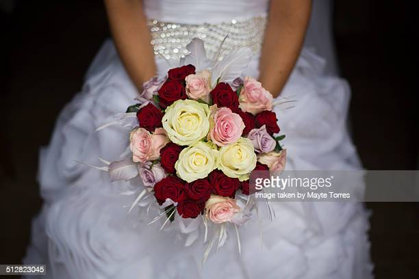 Bride holding roses bouquet
