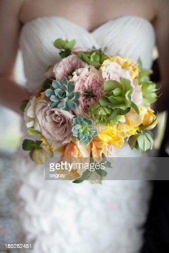 Bride holding springtime bouquet
