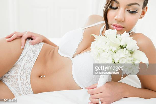 Bride in lingerie laying on bed
