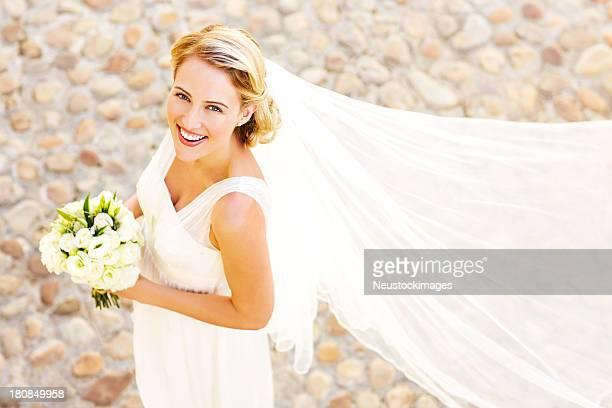 Bride in wedding dress holding a bouquet