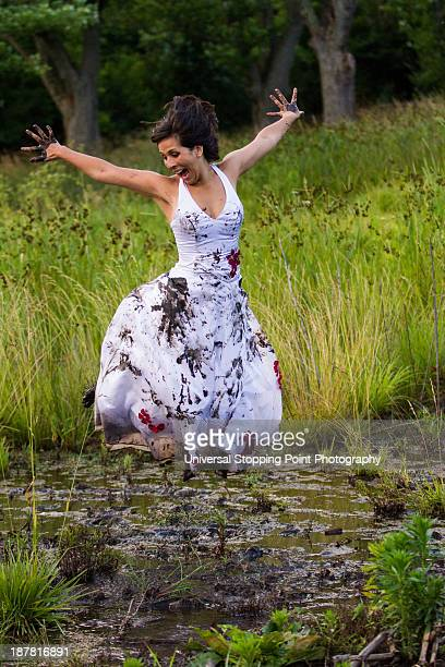 Bride Jumps in the Mud