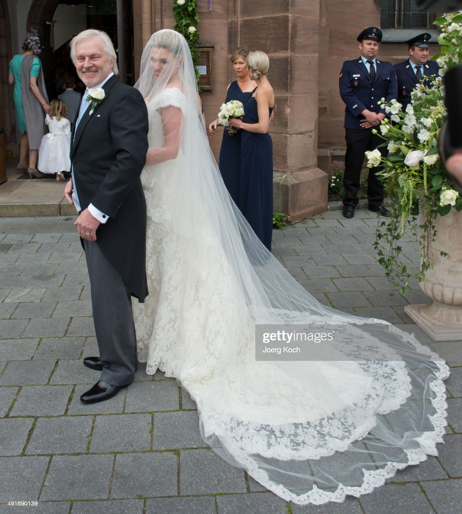 Bride Kate Stahl and her stepfather Jorgen Porse arrive at Martin-Luther-Church for her wedding on May 17, 2014 in Stein near Nuremberg, Germany.