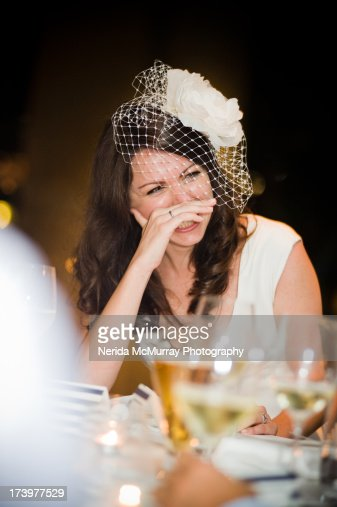 Bride laughing at speeches : Stock Photo