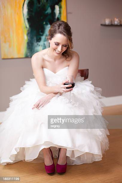 Bride laughing with glass of wine