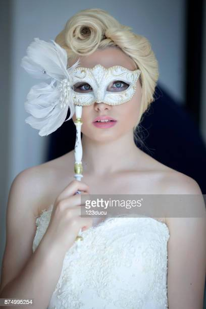 Bride Looking At Camera With Mask