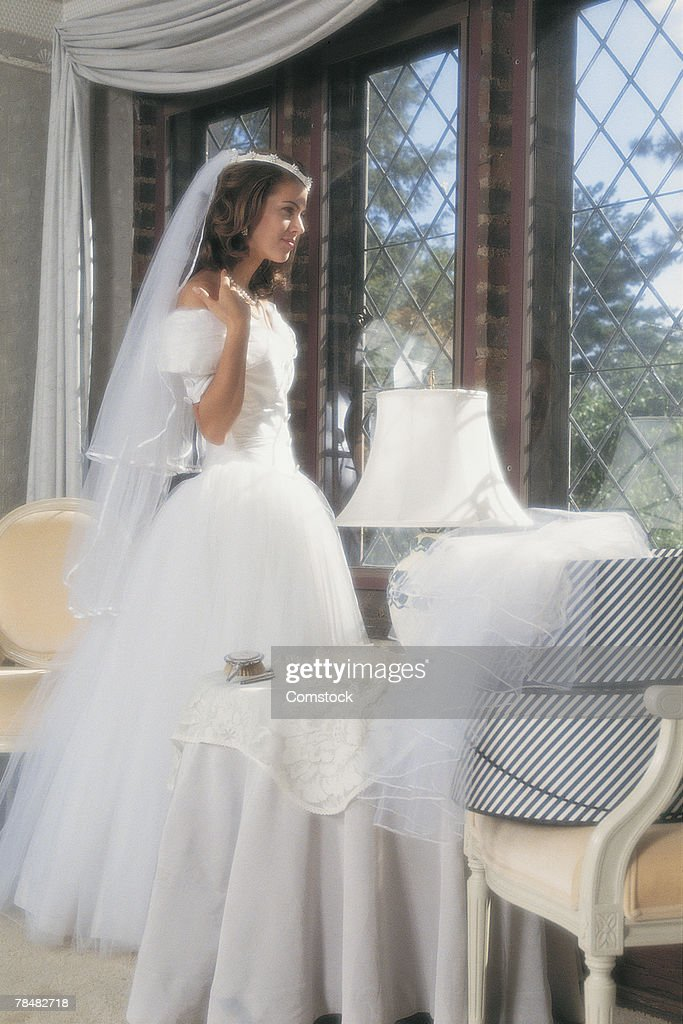 Bride looking out window : Stock Photo