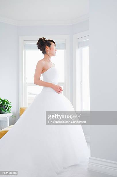 Bride looking out window.