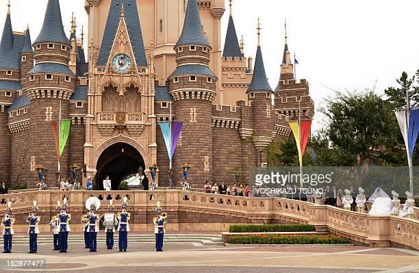 Bride Mayumi Kagoshi arrives at the Cinderella castle while her groom Takayuki Abiko waits at the balcony for their wedding at the Tokyo Disneyland...