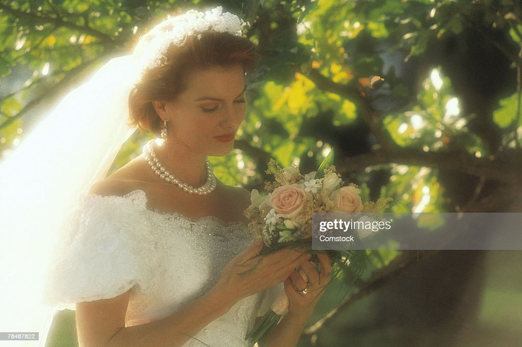 Bride outside with bouquet : Stock Photo
