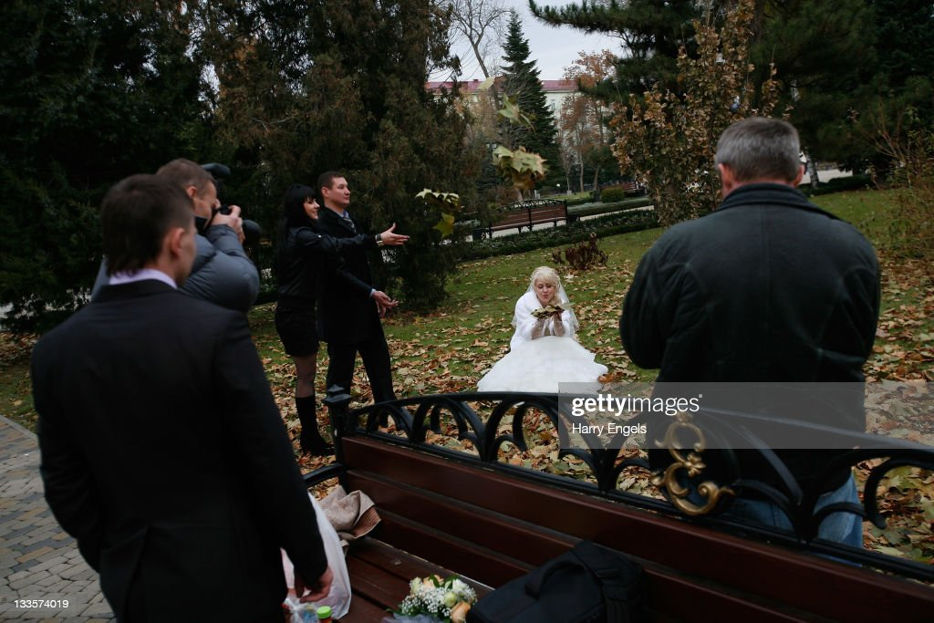 A bride poses for a photograph on November 19, 2011 in Krasnodar, Russia. Krasnodar is one of thirteen cities proposed as a host city as Russia prepares to host the 2018 FIFA World Cup.