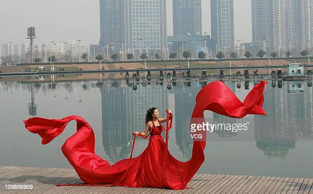 A bride poses for wedding photos on the International Women's Day on March 8 2011 in Zhengzhou Henan Province of China The official theme of the...
