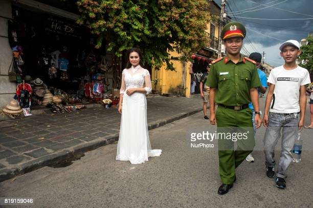 A bride poses in one of the streets of Hoi An a small town on the coast of the South China Sea