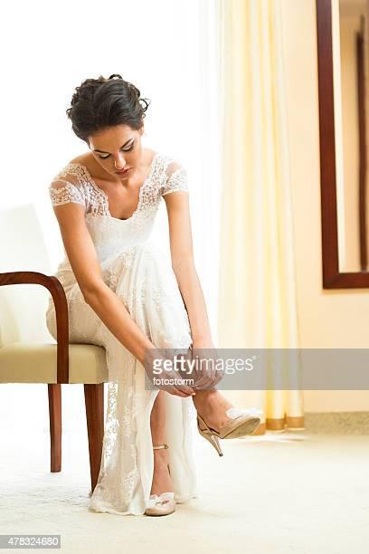 Bride preparation, putting wedding shoes on