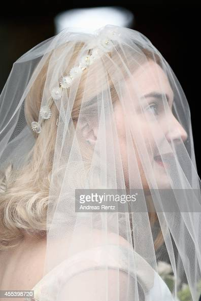 Bride Princess Maria Theresia von Thurn und Taxis smiles upon her arrival prior to her wedding ceremony to groom Hugo Wilson at the St Joseph church...