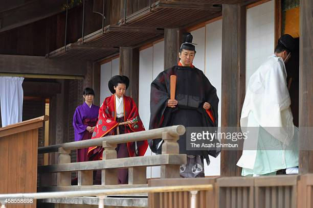 Bride Princess Noriko of Takamado and groom Kunimaro Senge walk a corridor of the hall in the Izumo Taisha grand shrine for their wedding ceremony on...