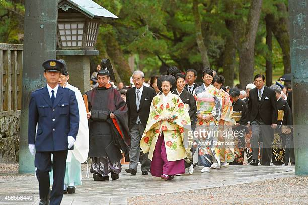 Bride Princess Noriko of Takamado and groom Kunimaro Senge walk to the hall in the Izumo Taisha grand shrine for their wedding ceremony on October 5...