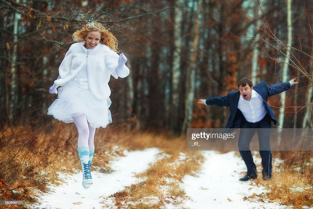 Bride - princess runs away from the groom : Stock Photo