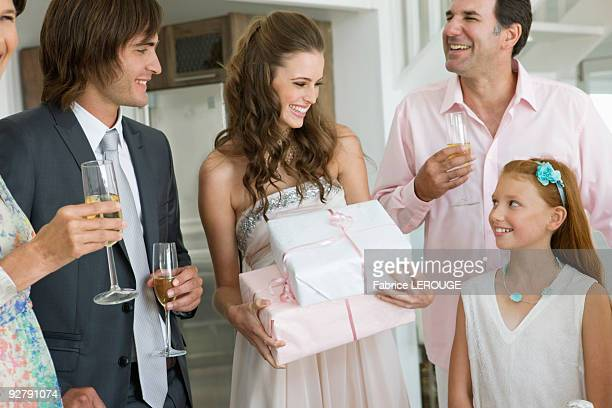 Bride receiving gifts from guests in a party