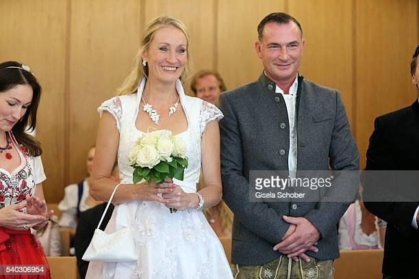 Bride Renata Kochta wearing a Dirndl by Astrid Soell with her husband Thomas Frank and her sister Marketa KochtaVanek during the wedding of Renata...
