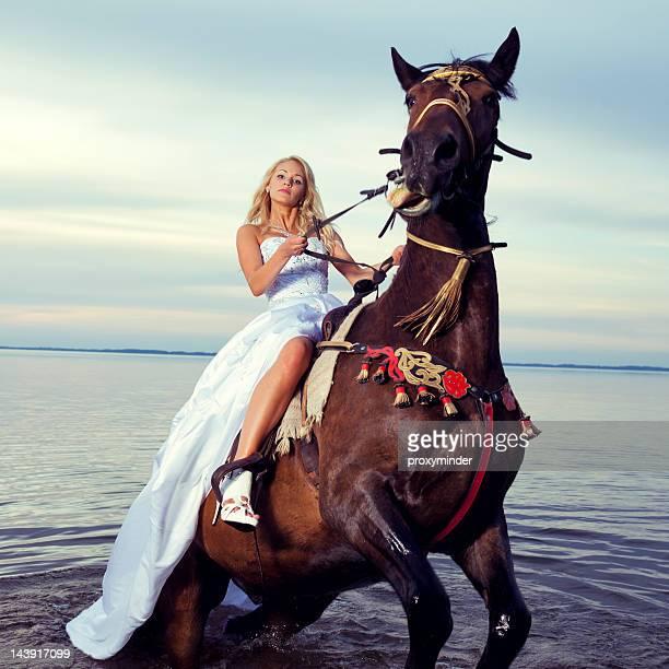 Bride riding a horse