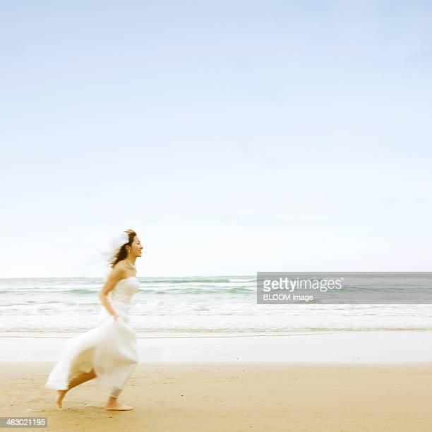 Bride Running At The Beach