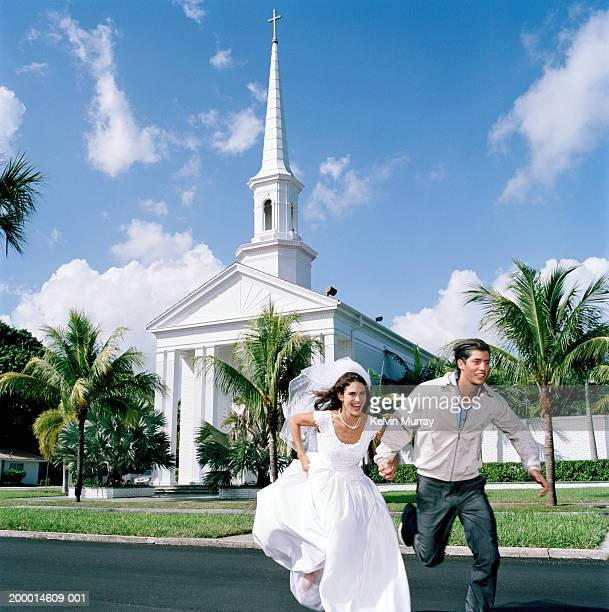 Bride running away from church with young man