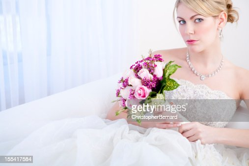 Bride sitting on white sofa