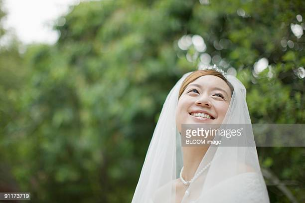 Bride smiling, looking upward