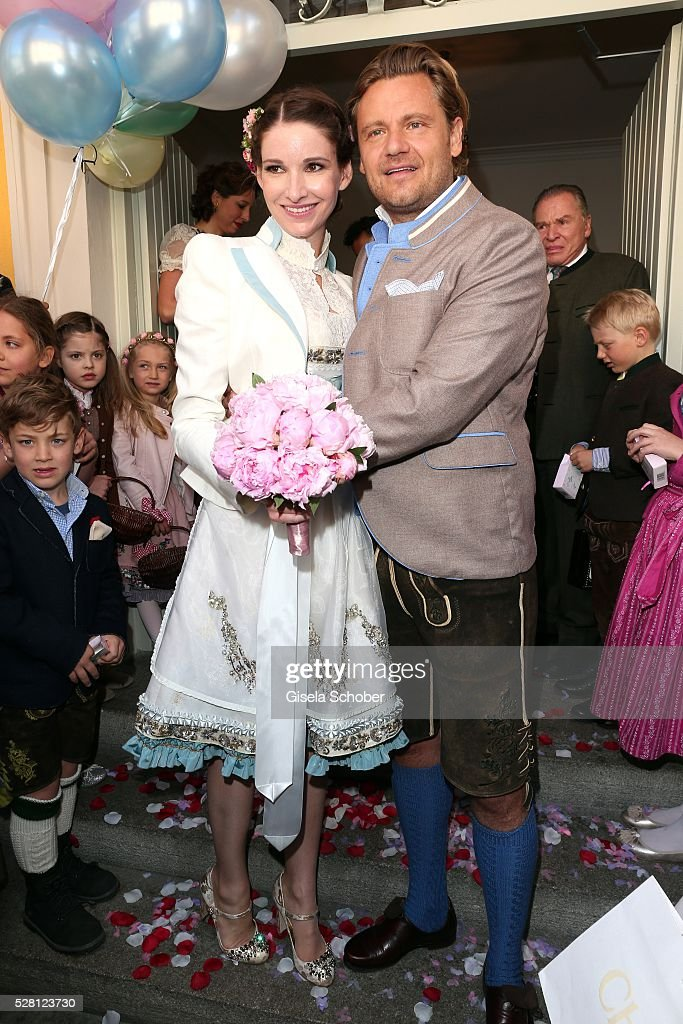 Bride Sophie Wepper and her husband Bridegroom David Meister during the wedding of Sophie Wepper and David Meister outside the registry office at Mandlstrasse on May 4, 2016 in Munich, Germany.