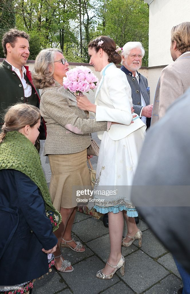 Bride Sophie Wepper and her mother-in-law, Ursula Schindler, during the wedding of Sophie Wepper and David Meister outside the registry office at Mandlstrasse on May 4, 2016 in Munich, Germany.