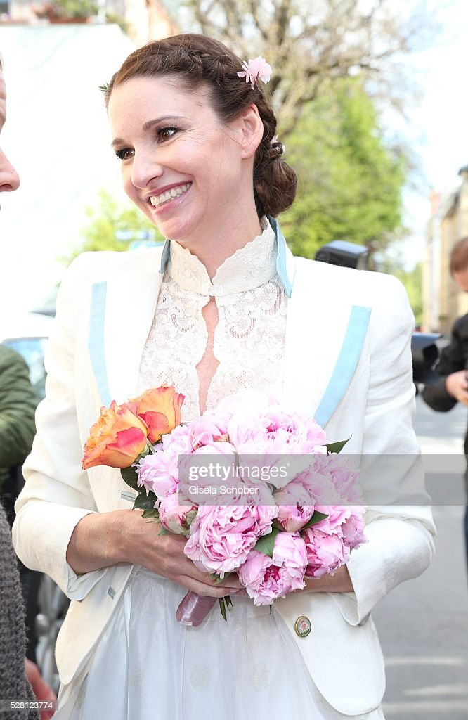Bride Sophie Wepper during the wedding of Sophie Wepper and David Meister outside the registry office at Mandlstrasse on May 4, 2016 in Munich, Germany.