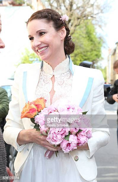 Bride Sophie Wepper during the wedding of Sophie Wepper and David Meister outside the registry office at Mandlstrasse on May 4 2016 in Munich Germany