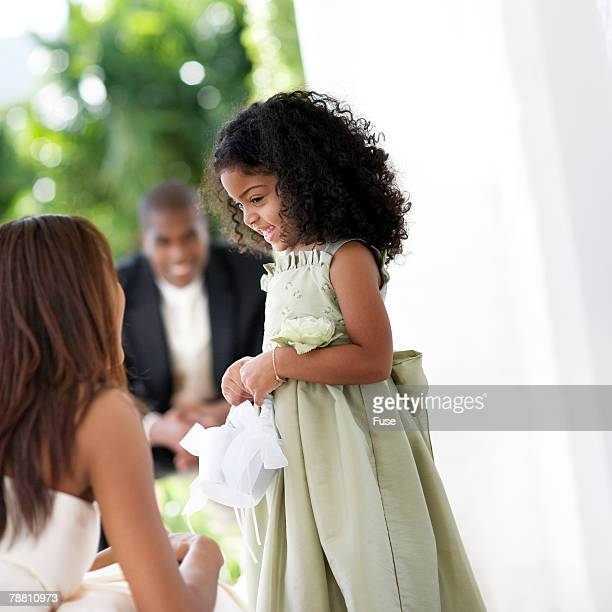 Bride Talking to Flower Girl