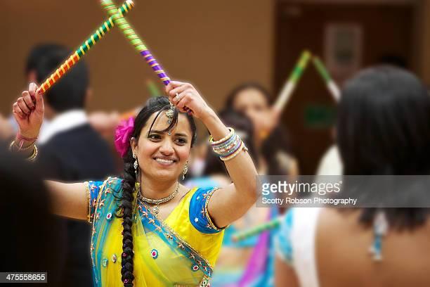 Bride to be celebrating with dandiya dancing