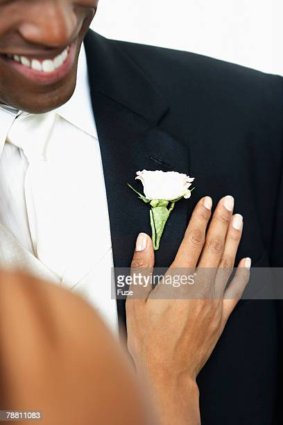 Bride Touching Grooms Chest
