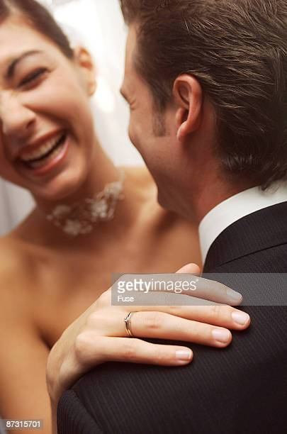Bride touching shoulder of groom