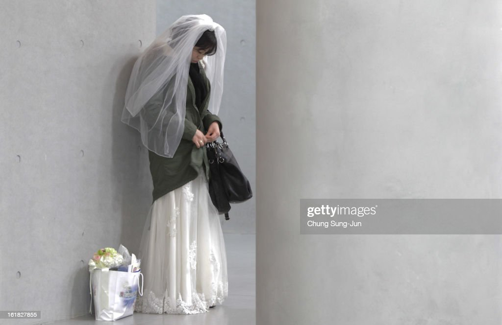 A bride waits for her wedding ceremony at Cheongshim Peace World Center on February 17, 2013 in Gapyeong-gun, South Korea. 3,500 couples from 200 countries around the world exchanged wedding vows for the first time after the Unification Church founder Moon Sun-Myung passed away.