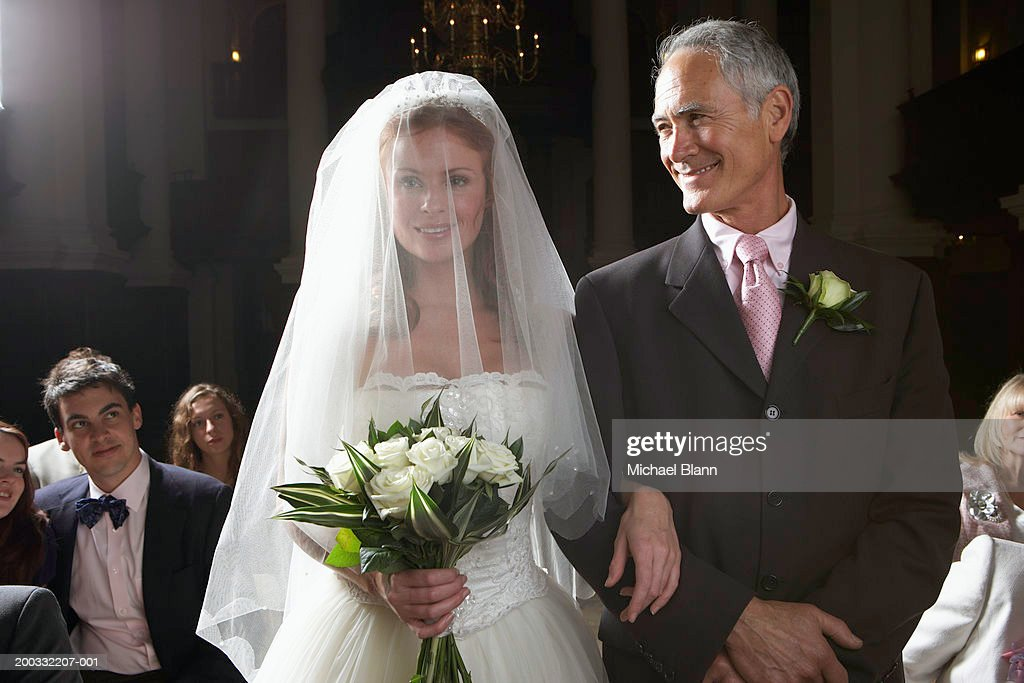 Wedding Songs Walk Down Aisle Church: Bride Walking Down Aisle Arm Linked With Fathers Smiling