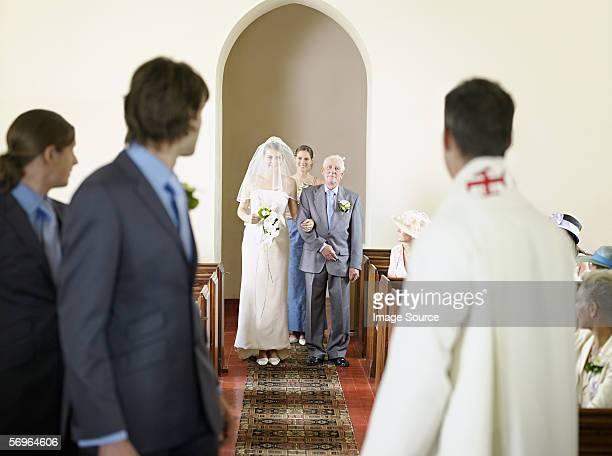 Bride walking down aisle at wedding